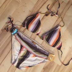 NWOT extremely high end swimwear! Komplique swimsuit! Very high end swim line. Never worn! Multi color stripes. Chain details. ❤️ offers! Open to trades. Size small Komplique Swim Bikinis