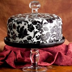 WOW! I would never want to own it because if I broke it i'd be pissed. But this is gorgeous. Black/White Domed Cake Stand Price: $189.99