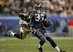 Running back Shaun Alexander #37 of the Seattle Seahawks tries to avoid a tackle by linebacker Joey Porter #55 of the Pittsburgh Steelers in the third quarter of Super Bowl XL at Ford Field on February 5, 2006 in Detroit, Michigan.