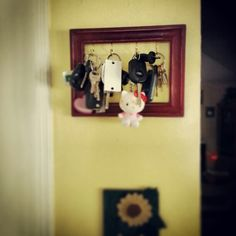 Dollar store picture frame - painted & distressed - hooks put in and there you have it...cute lil key holder....