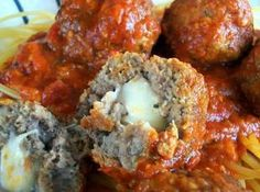 Mozzarella Stuffed Meatballs Recipe  Made these tonight and the kids devoured them.