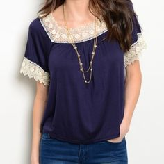 NWT Lace Trimmed Top NWT navy top and ivory lace trim on the collar and the sleeves. Size SMALL. Tops