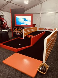 A custom built mini golf course by Holliday Events. From the frame to the paint to the Autozone logo, Holliday's can do it all! This was such a fun addition to this tent.