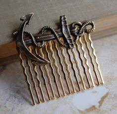 I want this! just add some bling! :) Anchor Hair Comb in Antique Brass by theriveriseverywhere on Etsy, $10.00