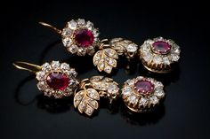 A Pair of Magnificent Imperial Era Antique Russian Double Cluster Long Earrings    these ruby and diamond gold earrings were made in St. Petersburg between 1908 and 1917