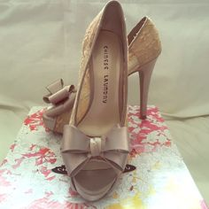 Chinese Laundry Lace Peep-toe Pump Nude lace with taupe satin trim & bow. Worn once for a wedding, in almost brand new condition. Chinese Laundry Shoes Heels