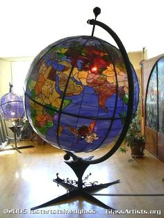 Stained  glass Globe - this would be gorgeous in my dream home.  this is a beautiful globe.