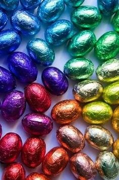 Colorful foil eggs. Decorating the table with these for Easter. #tablesettings.