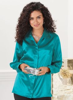 """Elegant satin tunic-length blouse with wing collar, front placket with hidden buttons, side slits and nice roomy fit. Soft woven polyester. Machine wash & dry. Imported.Approximate lengths: Petite - 27"""", Misses - 28"""", Women's - 30""""."""