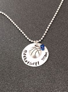 A personal favorite from my Etsy shop https://www.etsy.com/listing/203477013/hand-stamped-basketball-mom-necklace