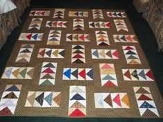 Flying Geese Quilt.  Love the scrappy look of the flying geese blocks.