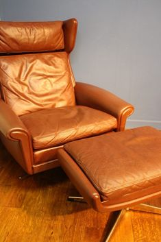 Mid Century Danish Leather Swivel chair and footstool. A really lovely version of a Danish leather swivel chair and matching footstool from the 1970's. This chair is very similar to a lot that are described as Skipper chairs, designed by Svend Skipper it also has some characteristics and design features similar to ones by Thams, …