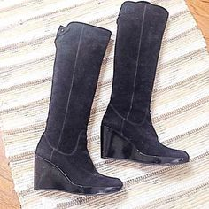 Stuart Weitzman boots Tall black suede with patten leather wedge heels. Worn on occasions - I'm more of a sporty girl and these are a bit too dressed up for me. Great condition - as seen on soles. Stuart Weitzman Shoes Wedges