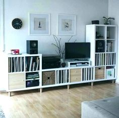 This entertainment center was built using KALLAX storage shelves and BRYNILEN be. This entertainment center was built using KALLAX storage shelves and BRYNILEN bed legs. Ikea Kallax Shelving, Ikea Hack Storage, Ikea Kallax Hack, Storage Shelves, Shelving Units, Ikea Hacks, Diy Hacks, Ikea Vinyl Storage, Diy Storage