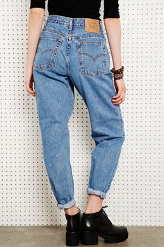 just bought a pair of mom jeans, trying to figure out how to wear them.