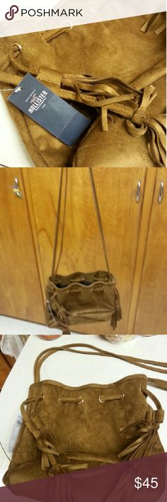 NWT HOLLISTER Brown Faux Suede Purse :) :) Authenic Brand New HOLLISTER BROWN FAUX SUEDE PURSE. Its very roomy and it has 2 pockets inside to hold your cell or keys & compact with lipstick as well. I purchased it off the rack in store at HOLLISTER.  :) Hollister Bags Shoulder Bags
