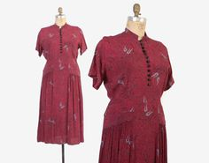 Vintage 40s rayon dress in a rare larger size. Wine colored rayon black and steel gray abstract print. Faceted black glass buttons at the bust. Fitted waist; 2 small pockets flaps on the skirt with gathers that fall below each pocket for movement. Side metal zipper. Unlined.  Label: none Size marked: none Best fits a modern xlarge. Please see measurements to ensure a great fit!  Bust: 43 Shoulder: 17 Sleeve length: 8 1/2 Sleeve opening: 17 Waist: 36 Hip: 42 Length: 49 1/2  Excellent...