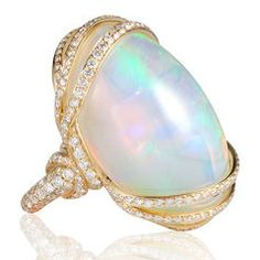 This ring has it all: it's iridescent and mesmerizing! The large opal stone is wrapped in 18K yellow gold and diamonds for a luxurious feel.