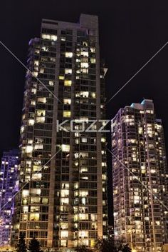 low angle shot of illuminated office building. - Low angle view of illuminated commercial building at nighttime.