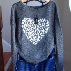 New! Express heart sweater Brand new express heart sweater. Heather gray with white leopard print heart. Blend of acrylic/wool/nylon/mohair. Warm and comfy. Please make offer or bundle for 20% discount. Express Sweaters Crew & Scoop Necks