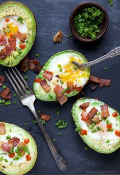 BAKED EGGS IN AVOCADO with crispy bacon and a Sriracha drizzle! The ultimate Paleo Breakfast, high in protein & fiber and loaded with flavor! I guarantee you'll be addicted after the 1st bite! | http://joyfulhealthyeats.com