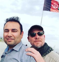 KABUL, Afghanistan (AP) — The Afghan president on Monday condemned the killing of David Gilkey, a veteran news photographer and video editor for National Public Radio, and an Afghan translator, Zabihullah Tamanna, who died in an insurgent ambush the day before while on assignment in southern Afghanistan.
