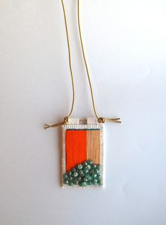 Colorblock embroidered pendant in orange tan teal and transparent teal glass beads on gold leather cord for Spring - An Astrid Endeavor