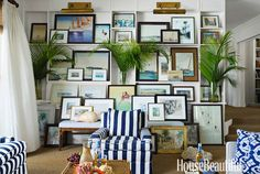 My favourite feature of Island Connoisseur Amanda Lindroth's home, love the leaning picture collage in the living room.    Image via House Beautiful