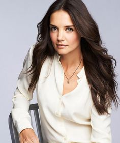 Katie Holmes is pro girl power! In the April issue of Elle UK, the 35-year-old actress says she supports women and is raising her nearly 8-year-old daughter, Suri, with ex-husband Tom Cruise to feel confident about herself.