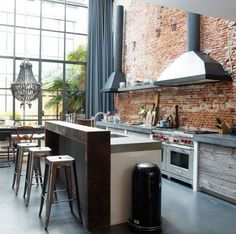 Get the look – modern industrial kitchens Rustic Kitchen Rough reclaimed timber, smooth concrete worktops and clean stainless-steel appliances combine to form an industrial kitchen with a rough, rustic edge — beautifully understated and incredibly chic. Industrial Kitchen Design, Industrial House, Rustic Industrial, Rustic Kitchen, Modern Rustic, Industrial Kitchens, Industrial Furniture, Industrial Bedroom, Industrial Office