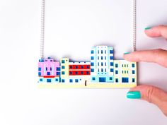 Miami Beach Ocean Drive statement necklace, hung from a silver plated curb chain with lobster clasp.  We recently went to Miami Beach, with its 1920s pastel coloured hotels and its. so. COOL!  Weve been interested in this style for a long time and planned the vacation around being in the same place as these awesome buildings, so we created this mini version to wear even if youre not cruising along Ocean Drive, South Beach!  Made with multiple layers of pastel and mirrored acrylic its quite…