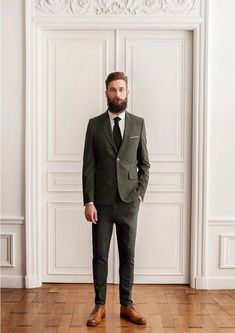 Shop this look on Lookastic:  https://lookastic.com/men/looks/olive-suit-white-dress-shirt-brown-brogues-olive-tie/10627  — White Dress Shirt  — Olive Tie  — Olive Suit  — Brown Leather Brogues