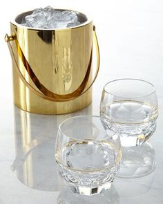 This gold ice bucket is on our wishlist.
