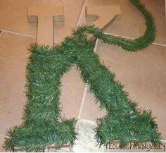 letter wrapped in Christmas tree garland