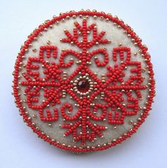 a brooch of Latvian mythological sign - Austras koks (tree of dawn) thought to represent world tree or axis mundi.