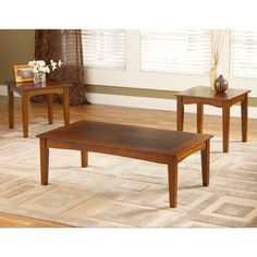 This handsome and versatile set of three tables are gracefully designed with tapered legs and scalloped aprons. Constructed from durable wood with a brown cherry finish that will match many decorative styles.
