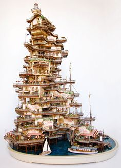 """Takanori Aiba decades it works great, is the world of illustration or architecture, but it was sensational creating """"mini-worlds"""" which seems to have met. Houses in bonsai, lighthouses, castles and even a Michelin bonecão are in a spectacular range of parts."""