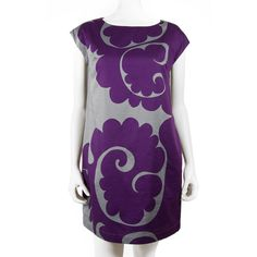 I like the style and cut of this dress, cap sleeves, but not the high contrast color choice, print could be okay in a different color scheme