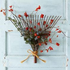 Turn a vintage rake head into a festive door decoration by winding bittersweet vine and placing sprigs of juniper berries between the tines. | 13 welcoming wreaths for fall | Living the Country Life | http://www.livingthecountrylife.com/homes-acreages/country-homes/13-welcoming-wreaths-fall/