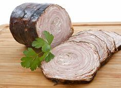 Originally from northern France, especially Normandy and Brittany, andouilles are large smoked sausages sliced and eaten cold. In the Middle Ages they were considered a delicacy. Andouilles are filled with tripe, cut-up large intestines, and belly—all from pig. Twisting all of this into the black casing is no easy matter