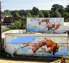 The 20 Best Murals of 2014 - Location: Atlanta Fintan Magee is known for his levitating figures, and his dual pair of walls in Atlanta served as the perfect locations for the artist.