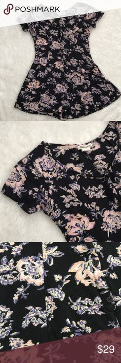 Billabong Floral Romper Billabong black romper with soft floral pattern. Good condition. Size S Billabong Other