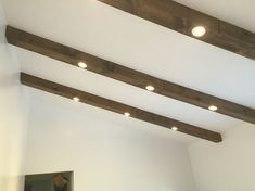 Faux wood beams with recessed lights