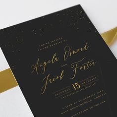 You'll fall in love with the Starry Sky Wedding Invitation Suite - it's exquisite black and gold design depicts the night sky in luxurious gold foil