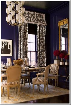 loving the light fixture and deep indigo lacquered walls.
