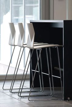 Hightower Quickship bar/counter stools, Stackable – 10 High. High comfort level. Available with polyamide seat or lacquered bentwood. Seat can also be specified with an upholstered...