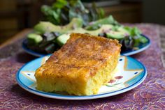 Huminta: A Bolivian Delight Makes 6 servings  ½ cup yellow corn meal  ½ cup all-purpose flour  1 teaspoon baking powder  ¾ teaspoon salt  1 – 15 ounce can whole kernel sweet corn  ½ cup milk  ¼ cup canola oil  2 eggs  4 ounces sharp cheddar cheese  ½ teaspoon mild chili powder  An 8×8 square glass baking pan, buttered