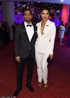 A pal at the galal: The stunner put her arm around fellow actor Aziz Ansari...