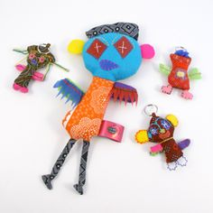 """shwe shwe friends from SA. these are small fabric dolls made form traditional African printed cotton called """"shwe'shwe"""" The charming dolls are based on children's drawings from needy kids living in hard conditions in S.A.."""