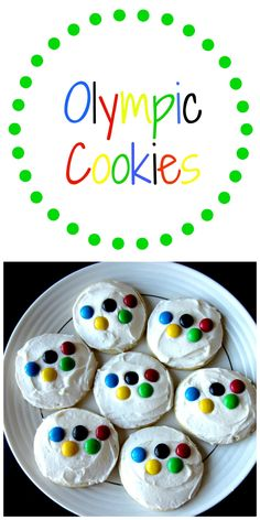 Olympic Cookies- The perfect treat to enjoy while celebrating the Olympics! A soft and delicious sugar cookie topped with heavenly buttercream frosting and M&M's representing the Olympic rings.